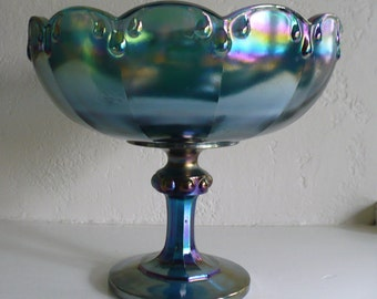 Vintage blue carnival glass pedestal bowl with scalloped rim