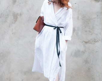 White wrapped women's linen dress, available in white and black, long sleeve, with pockets, handmade in high quality