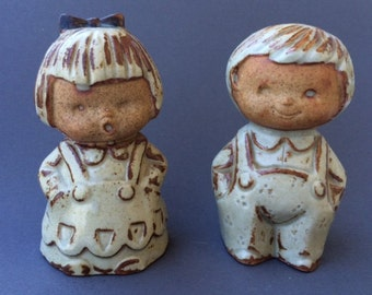 Japanese pottery boy and girl, salt and pepper shakers