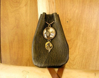 """Female Pilot, black and gold leather drawstring pouch with a glass charm and wing charm, 4.5"""" x 3"""" adjustable 36"""" gold nylon neck cord"""