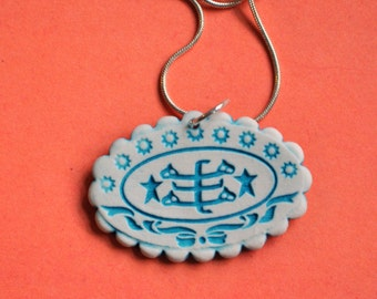 """Baha'i Ringstone Symbol Necklace- porcelain, scalloped oval in turquoise blue and white- """"Bahji Blue"""""""