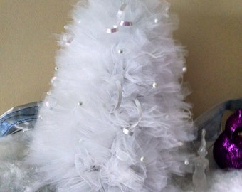 Beautiful white tulle tree with added ribbons and pearls