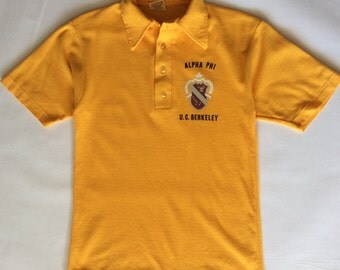 Vintage U.C. Berkeley Alpha Phi polo shirt, 1970's, brilliant golden yellow with black, maroon, gray & white print, slim fit, small / medium