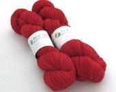 Hand dyed silver sparkle sock yarn. No Place Like Home. Superwash merino/nylon/stellina. Semi solid red. Fingering weight, 4ply, 4-ply