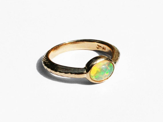 Gold and Opal Solitaire Ring