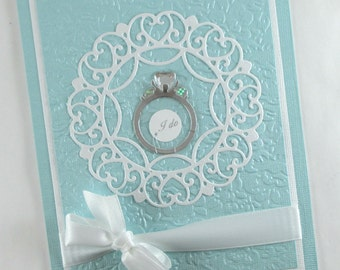 Wedding card, wedding day, wedding ring, diamond ring, congratulations, bride and groom,  blue and white