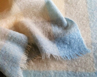 Beautiful mohair baby blanket, made in Ireland, in soft blues, greys, and ivory.