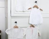 four vintage baby dresses
