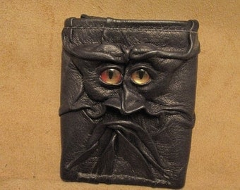 Grichels leather tri-fold wallet - black with red and gold slit pupil shark eyes