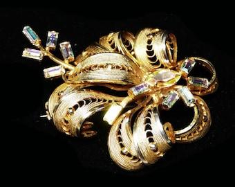 Filigree Rhinestone Flower Vintage Brooch - Goldtone Designer Signed Continental with Aurora Borealis Baguettes