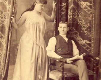 Woman in NIGHTGOWN Pulls Back The CURTAINS to See Seated Young Man Reading a Book RISQUE Photo Circa 1900