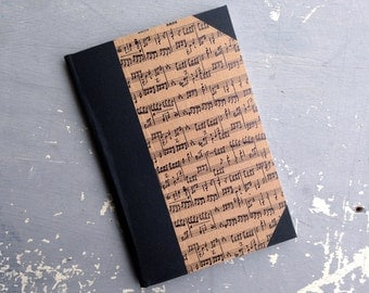 Pamphlet Binding - Half bound in book cloth and brown music paper