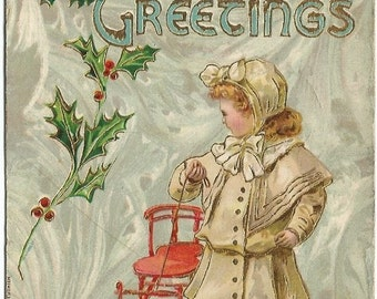Girl in White Coat Pulling Old Fashioned Sled Hearty Christmas Greetings Vintage Postcard Gelatin Finish Holly