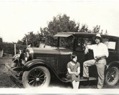 Old Photo Couple with Car Woman sitting on car Runner Man Leg up on Car Runner 1930s Photograph snapshot vintage Automobile
