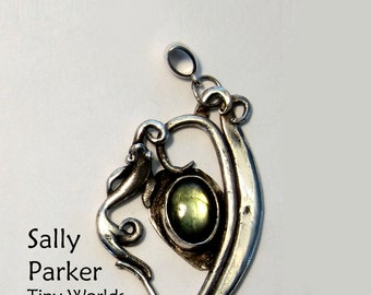 A Silver Pendant with Waves, Fish, and Labradorite