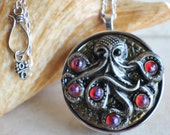 Octopus music box locket, round silver tone locket with music box inside and octopus on front cover.