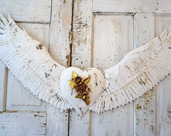 Angel wings wall hanging metal Santos style heart center French Nordic papery white rusted attached wing set home decor anita spero design