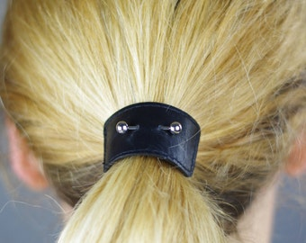 Black leather hair elastic with silver-tone brass piercing. Hair tie - ponywrap - ponytail tie - hair accessory - ponytail holder