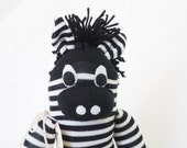 Sock animal, sock zebra, sock monkey, soft plush toy for children. Black and white. Zeke Zebra.