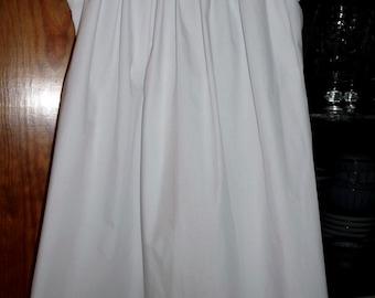 Hand smocked bishop dress with geometric design