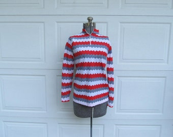 1970s vintage women's zip front blouse with chevron zig zag, red, gray, and white, M