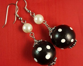 Classic black wood bead with white polka-dot earrings accented with pearlized beads