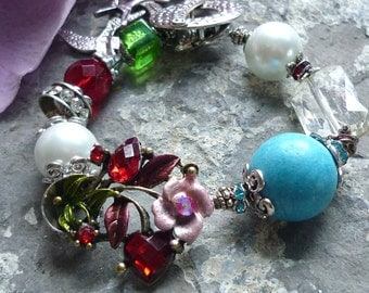 bracelet robins egg color with bird and glass pearl and crystal the style is elegant colorful with flower and leafs.  DIY downton abbey look