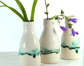 Bud vase, milk bottle ceramic vase with landscape painting in glazes. A modern white vase for room decor and contemporary interior design.