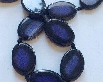 full strand of oval purple fire agate beads. GR
