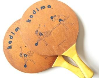 Two vintage wood kadima paddles with yellow handles