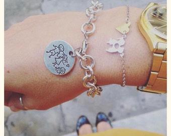 Aluminum bracelets with family pendant in brass