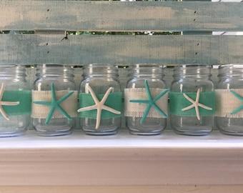 6 glass jars with hand painted sea stars.