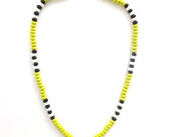 lime green colored surfer style necklace. Yellow, green with black and white stripes. Retro beaded beach style, with barrel clasp.