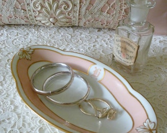 Vintage porcelain trinket dish for your pretty vanity table.  Oval with pale pink and gold accents.