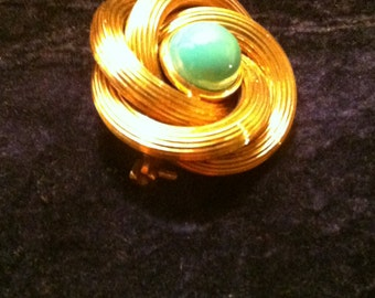 Flower pin curled up with turquoise, 18 kt gold, vintage, early ' 80.