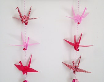 Mobile in origami, pink and red colours