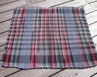 Black, red, green and grey with grey stripe handwoven rag rug made from recycled sweatshirts