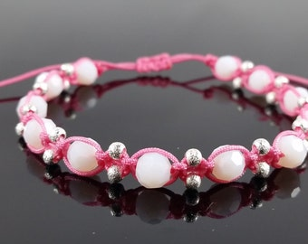 Pink macramé bracelet with white faceted beads and silver color beads