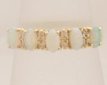 Ladies Oval Cut Opal & Round Cut Diamond Band 14K