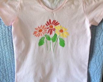 Light pink t-shirt with bright Gerbera daisies stenciled on it, ladies small