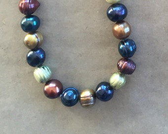 Freshwater Pearls, blue copper gold russet 11 mm   (Item # 5189)