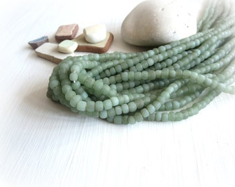 Small soft green glass seed beads, matte organic rustic style , tube barrel spacer Modern Indo-pacific  3 to 6 mm / 22 inches 5A4-22