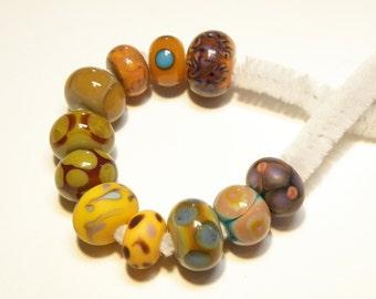 DESTASH -- 11 Assorted Rondelle Orphan Lampwork Beads: Autumn Colors -- Lot 3F