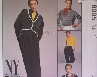 McCall's 8095. Size 12. Misses' unlined jacket, top and pants pattern. Pattern is uncut and factory folded.
