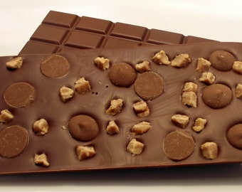 Luxury chocolate bar with caramel and fudge pieces