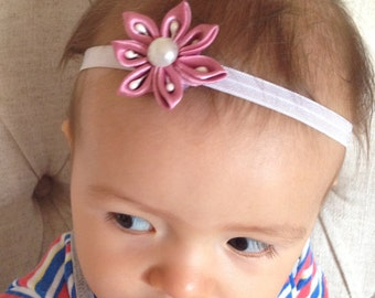 Satin flower baby headband.