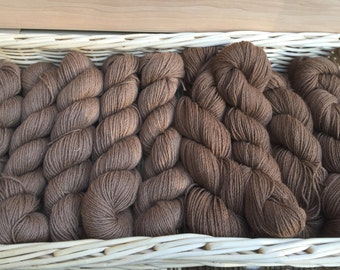 100% Sport Weight  Alpaca yarn,  color: fawn, white, or beige