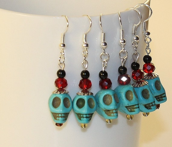 items similar to dangle skull earrings with