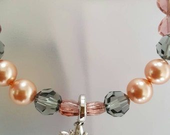 A very attractive swavroski crystals and pearls charm necklace for our little princess
