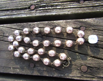 """10mm Baroque glass pearls 18"""" long with a pretty Swarovski crystal dangling from it ."""